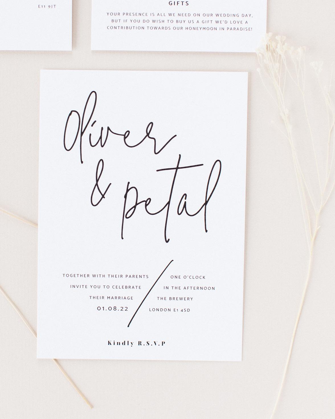 Script wedding white invitation with black modern script font