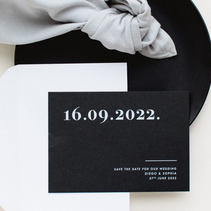 Bold Note black save the date with bold white typography