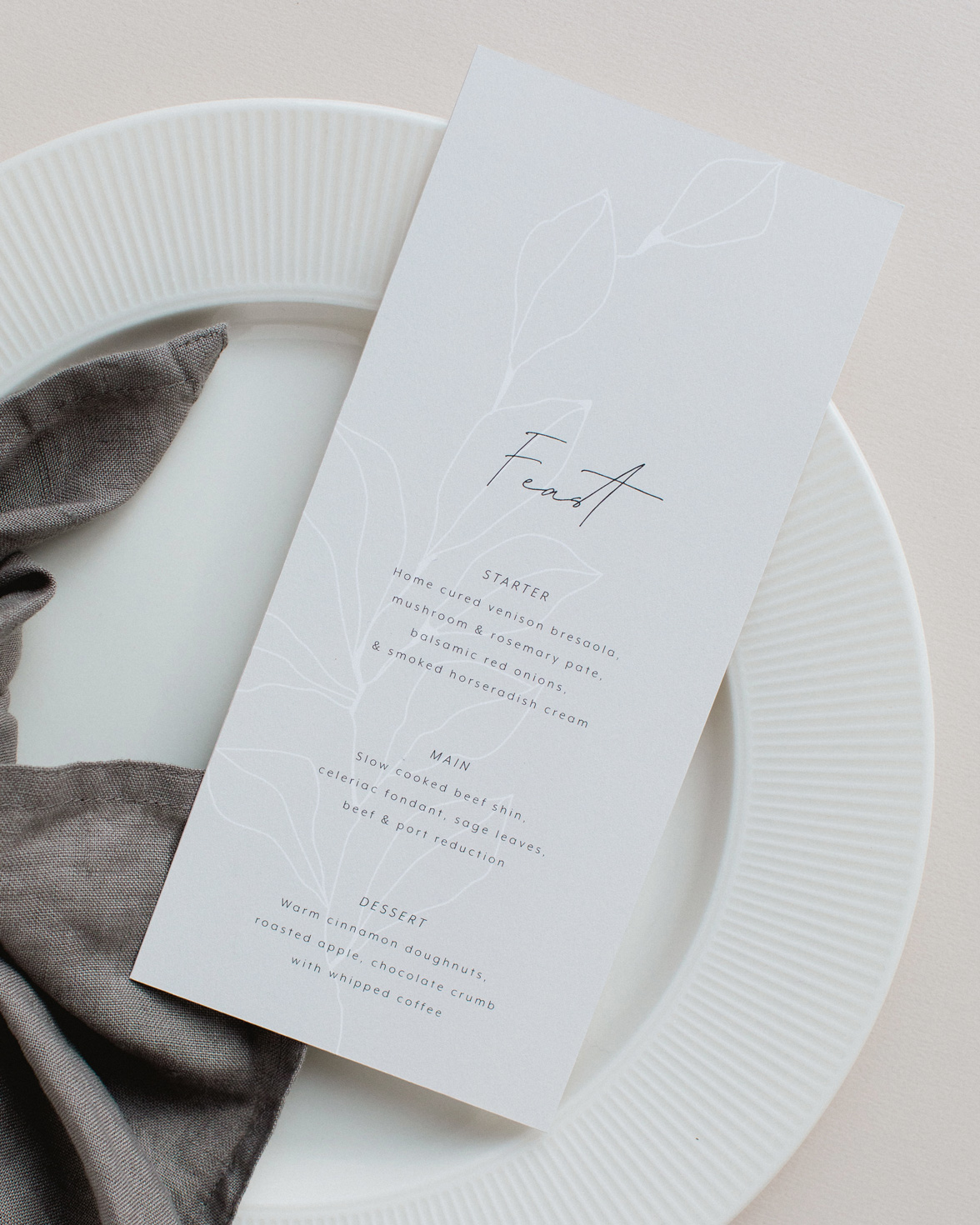 Fleur Classique wedding menu. Natural tones with hand drawn flower motif