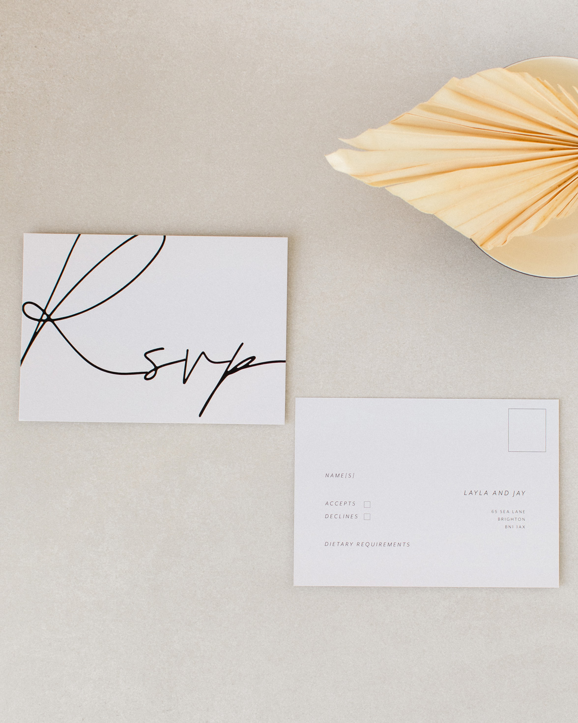 Libre Firma Wedding RSVP. Grey card, black script font