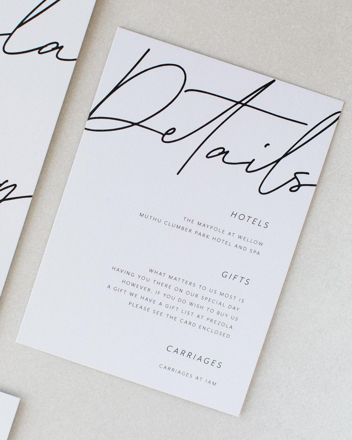 Libre Firma Wedding details card. Grey card, black script font