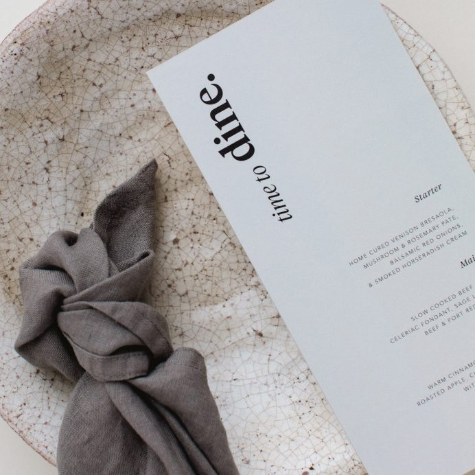 Duly Noted wedding menu in grey with bold black typography