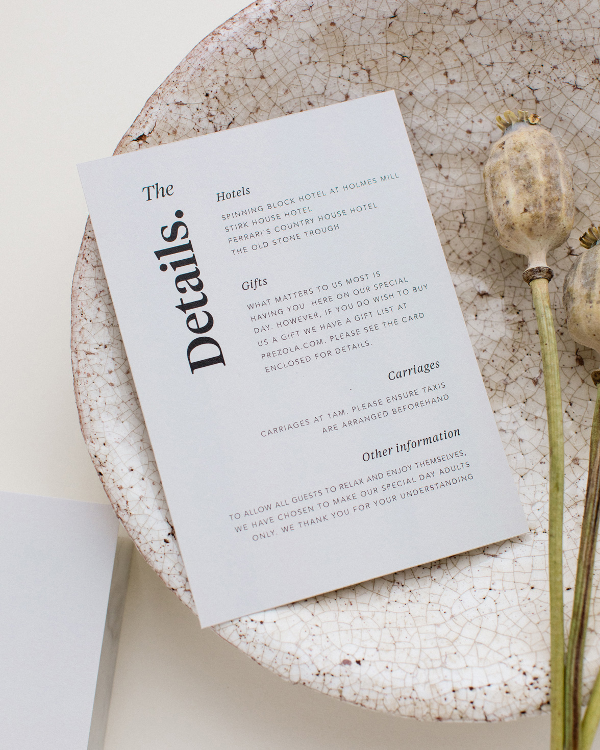 Duly Noted wedding details card in grey with bold black typography