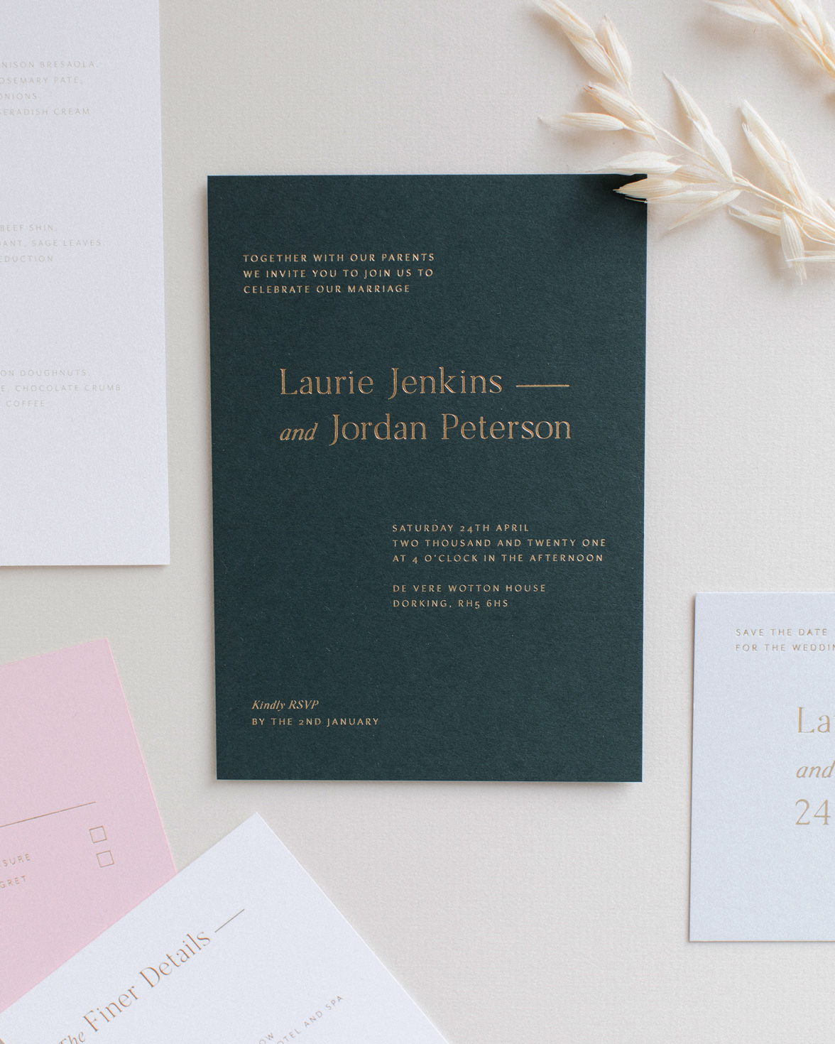 Refined gold wedding invitation in racing green with gold foil print