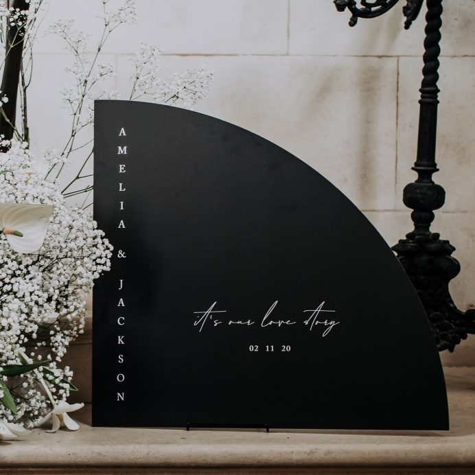 arched wedding welcome sign